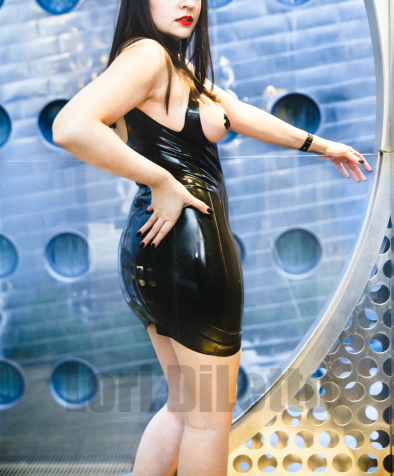New York City Dominatrix professional switch Lori DiLetto black latex dress red lipstick