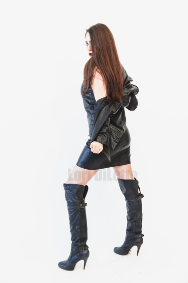 New York City dominatrix professional switch Lori DiLetto black leather knee high boots leather dress leather jacket